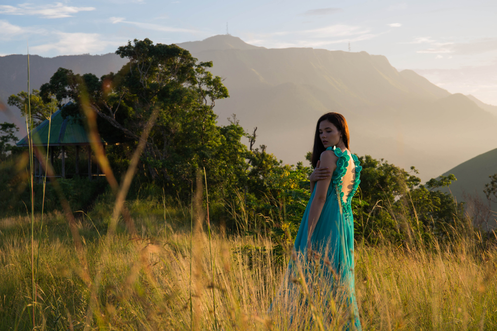 Catriona Gray photographed atop of Mt Tapyas, Coron Palawan, Philippines at the break of dawn wearing designer Francis Libiran.