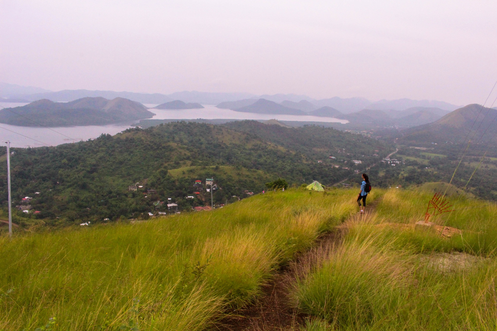 Coron Travel Diary | cat-elle.com. Atop Mt. Tapyas, Coron amongst beautiful grassy fields.